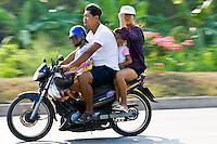 Family travel on a motorcyle, Bangkok, Thailand