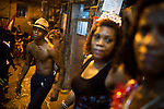 Residents in the streets during Carnaval in Rocinha, the biggest favela in Brazil, with over 100,000 residents, in Rio de Janeiro, Br., on Thursday, Jan. 24, 2013. In early November 2011 about 3,000 police officers and soldiers moved into one of the largest slums in Latin America in an effort by the Brazilian government to assert control over lawless areas of the city ahead of the 2014 World Cup and 2016 Summer Olympics.