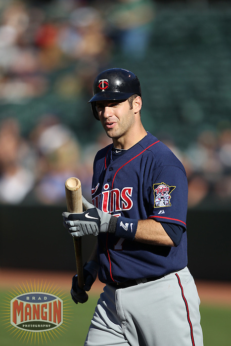 OAKLAND, CA - JUNE 5:  Joe Mauer #7 of the Minnesota Twins bats against the Oakland Athletics during the game at the Oakland-Alameda County Coliseum on June 5, 2010 in Oakland, California. Photo by Brad Mangin
