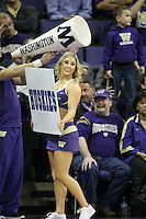 February 12, 2014:   UW Cheer member Sarah Madsen entertained fans during the game between Washington's against Stanford.  Washington defeated Stanford 64-60 at Alaska Airlines Arena in Seattle, Washington.