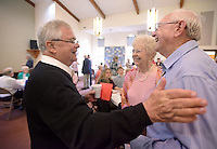 NWA Democrat-Gazette/BEN GOFF @NWABENGOFF<br /> Pastor Fred Nelson (left) talks with Alice Rahlfs and husband Roger Rahlfs on Sunday May 29, 2016 during a retirement reception for Nelson at United Lutheran Church in Bella Vista. Nelson was the pastor of the church for over five years before stepping down in 2009 to serve as interim pastor for other congregations. Nelson served his last day in the pulpit at United Lutheran earlier in May after returning to serve as interim pastor for the congregation over the past 18 months.