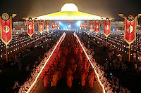 Buddhist monks leave after a ceremony at the Wat Phra Dhammakaya temple in Pathum Thani province, north of Bangkok on Makha Bucha Day March 4, 2015. The Dhammakaya temple members include some of Thailand's most powerful politicians and is regarded as the country's richest Buddhist temple. Makha Bucha Day honours Buddha and his teachings, and falls on the full moon day of the third lunar month.  REUTERS/Damir Sagolj (THAILAND)