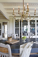 The simple kitchen/dining area is decorated with an ornate brass chandelier
