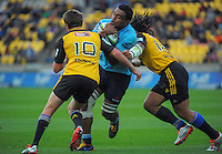 Beauden Barrett and Ma'a Nonu combine to stop Waratahs number eight Wycliff Palu during the Super Rugby match between the Hurricanes and Waratahs at Westpac Stadium, Wellington, New Zealand on Saturday, 18 April 2015. Photo: Dave Lintott / lintottphoto.co.nz