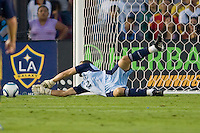 Goalkeeper Jerzy Dudek of Real Madrid makes a save to his right.            Real Madrid beat the LA Galaxy 3-2 in an international friendly match at the Rose Bowl in Pasadena, California on Saturday evening August 7, 2010.