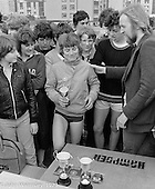 The winner being presented with her cup, Sports Day at the Education Centre, Wester Hailes, Scotland, 1979.  John Walmsley was Photographer in Residence at the Education Centre for three weeks in 1979.  The Education Centre was, at the time, Scotland's largest purpose built community High School open all day every day for all ages from primary to adults.  The town of Wester Hailes, a few miles to the south west of Edinburgh, was built in the early 1970s mostly of blocks of flats and high rises.