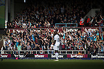 West Ham United 2 Crystal Palace 2, 02/04/2016. Boleyn Ground, Premier League. Home fans in the Chicken Run section of the East Stand celebrating their team's equalising goal in the first-half at the Boleyn Ground as West Ham United hosted Crystal Palace in a Barclays Premier League match. The Boleyn Ground at Upton Park was the club's home ground from 1904 until the end of the 2015-16 season when they moved into the Olympic Stadium, built for the 2012 London games, at nearby Stratford. The match ended in a 2-2 draw, watched by a near-capacity crowd of 34,857. Photo by Colin McPherson.