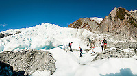 Group of guided hikers on Franz Josef Glacier, Westland Tai Poutini National Park, West Coast, UNESCO World Heritage Area, New Zealand, NZ