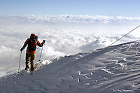 Gulmarg, Kashmir. The stunning vista of the winter Himalayas provides the backdrop for a skier at the top of the Gulmarg gondola (3980m). The gondola which opened in 2005 is the worlds highest and has been drawing snowboarders and skiers from around the world. Gulmarg is only 10km from the line of control that seperates Pakistan Kashmir from Indian Kashmir which means its situated in a conflict area. But improved relations between the two countries as well as a peace process within Kashmir have meant more skiers are now flocking to the area for what is said to be some of the best skiing in the world.