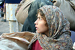 An Afghan girl waits on at the Jalozai refugee camp near Peshawar for relocation by the UN to a camp closer to the Afghan border..