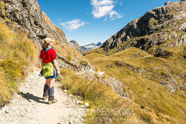 Young woman, tramper on Routeburn Track at Harris Saddle, Mt. Aspiring National Park, UNESCO World Heritage Area, Central Otago, New Zealand, NZ