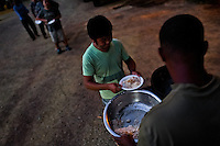A Panamanian soldier distributes food among Nepalese immigrants in the border police checkpoint in Darién gap in Panama, 30 January 2015.