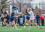 25 April 2015: University of Vermont Catamount Midfielder Danielle Seifert, a Junior from Fallston, MD, is checked by University of New Hampshire Wildcat Midfielder Carly Wooters, a Freshman from White Plains, NY, during game action at Virtue Field in Burlington, Vermont. The Lady Catamounts defeated the Lady Wildcats 12-10 in the final game of the season, advancing to the America East playoffs. Mandatory Credit: Ed Wolfstein Photo *** RAW (NEF) Image File Available ***