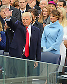 Donald J. Trump waves to the crowd as he arrives to be sworn-in as the 45th President of the United States on the West Front of the US Capitol on Friday, January 20, 2017. Malaria Trump looks on.<br /> Credit: Ron Sachs / CNP<br /> (RESTRICTION: NO New York or New Jersey Newspapers or newspapers within a 75 mile radius of New York City)