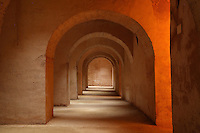 Arched corridor in the huge underground prison Habs Qara where Sultan Moulay Ismail, or Moulay Ismail Ibn Sharif, reigned 1672ñ1727, second ruler of the Alaouite dynasty, is alleged to have kept Christian prisoners, Meknes, Meknes-Tafilalet, Morocco. Meknes is a fortified Imperial city redeveloped under Moulay Ismail, as Morocco's political capital. Picture by Manuel Cohen
