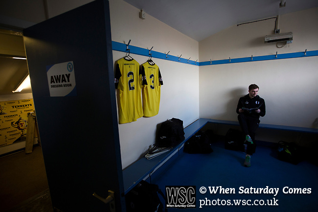 Forfar Athletic 1 Edinburgh City 2, 02/02/2017. Station Park, SPFL League 2. Visiting defender Chris McKee reading a match programme in the dressing room at Station Park, Forfar before the SPFL League 2 fixture between Forfar Athletic and Edinburgh City. It was the club's sixth and final meeting of City's inaugural season since promotion from the Lowland League the previous season. City came from behind to win this match 2-1, watched by a crowd of 446. Photo by Colin McPherson.