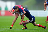 James Beal of Great Britain takes on the France defence. FISU World University Championship Rugby Sevens Men's Semi Final between Great Britain and France on July 9, 2016 at the Swansea University International Sports Village in Swansea, Wales. Photo by: Patrick Khachfe / Onside Images