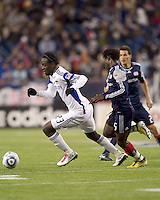 Kansas City Wizards midfielder Kei Kamara (23) dribbles as New England Revolution defender Emmanuel Osei (5) defends. The New England Revolution defeated Kansas City Wizards, 1-0, at Gillette Stadium on October 16, 2010.