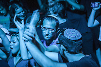 August 27, 2014 - Binyamina, Haifa District, Israel: Religiuos Jewish youth and fans of Orphaned Land heavy metal band are seen during a concert in Binyamina Amphitheatre at north of Israel. Orphaned Land is a music band founded by Jewish and Arabian musicians who combine ethnic music with rock metal as they recite verses in Hebrew and Arabic from the sacred Quram and Tora Scriptures. (Narciso Contreras/Polaris)
