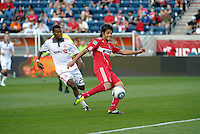 Chicago midfielder Sebastian Grazzini (10) takes a shot as Toronto defender Danleigh Borman (25) looks on.  The Chicago Fire defeated Toronto FC 2-0 at Toyota Park in Bridgeview, IL on August 21, 2011.