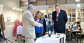 Paul Hoffman, Head of Adult Learning at Surrey County Council (dark suit), visits taster demonstrations which were put on to encourage people to join classes, during the opening of an exhibition of students' work, Adult Learning Centre, Guildford, Surrey.