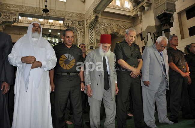 Egyptian Islamist groups attend prayers on al-Qaida leader Osama Bin Laden, following the Friday prayer in the Nour mosque in Cairo, Egypt, Friday, May 6, 2011. Al-Qaida on Friday confirmed the killing of Osama bin Laden and warned of retaliation, saying Americans' 'happiness will turn to sadness. Photo by Ahmed Asad