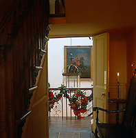 A glimpse of the festive green and red garlands that decorate the balustrade around the stairwell