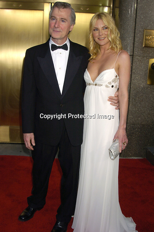 John Patrick Shanley and girlfriend Paula Devicq..arriving at the 59th Annual Tony Awards on June 5, 2005 at ..Radio City Music Hall. ..Photo by Robin Platzer, Twin Images