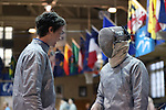 11 February 2017: Duke's Pascual Di Tella (left) gives some advice to Peter Yang (right) during Saber. The Duke University Blue Devils hosted the Boston College Eagles at Card Gym in Durham, North Carolina in a 2017 College Men's Fencing match. Duke won the dual match 18-9 overall, 9-0 Foil, and 6-3 Saber. Boston College won Epee 6-3.