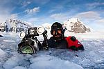 Film maker Stuart Ireland, member of the Elysium Expedition Film team, in Brash Ice near Danco Island, Antarctic Peninsula