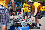 James Kuzmaul drags Mountain View High School's robot from the playing field after the first round of a frisbee throwing at RoboNanza June 27.