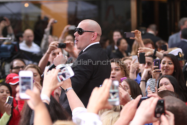 May 25, 2012: Pitbull performs during his appearance on the NBC Today Show Toyota Concert Series in New York City. © RW/MediaPunch Inc.