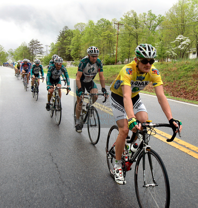 Race leader Floyd Landis (right), of Phonak Hearing Systems, rides with the peloton during Stage 5 of the Ford Tour de Georgia on Saturday, April 22, 2006. Tom Danielson, of the Discovery Channel Pro Cycling Team, won the 94.5-mile (152.1-km) stage from Blairsville to the top of Brasstown Bald, the highest point in the state. Landis finished second and retained the race lead.<br />