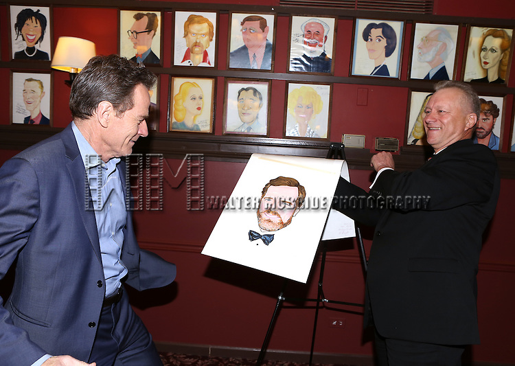Bryan Cranston and Max Klimavicius attends the Sardi's Caricature Unveiling for Bryan Cranston on May 29, 2014 in New York City