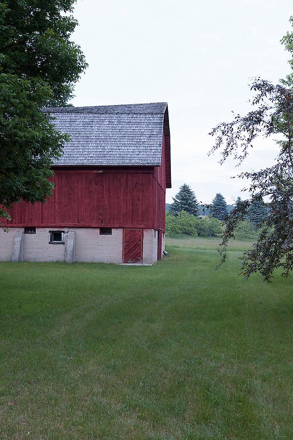 Red barn at dusk, near Empire, Michigan, Traverse City area, MI, USA