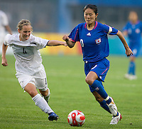 New Zealand midfielder (4) Katie Hoyle tries to keep up with Japanese midfielder (10) Homare Sawa during first round play in the 2008 Beijing Olympics at Qinhuangdao, China. .  Japan tied New Zealand, 2-2, at Qinhuangdao Stadium.