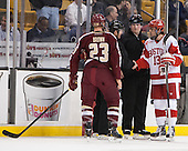Patrick Brown (BC - 23) and Garrett Noonan (BU - 13) meet with Scott Hansen and Tim Low. - The Boston College Eagles defeated the Boston University Terriers 3-1 (EN) in their opening round game of the 2014 Beanpot on Monday, February 3, 2014, at TD Garden in Boston, Massachusetts.