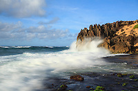 At sunrise, a wave jumps in slow motion onto the pinnacles of Maha'ulepu Heritage Trail, southern shore of Kaua'i.