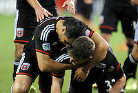 Washington D.C. - April 26, 2014:  Bobby Boswell (32) of D.C. United  celebrates his score with teammate Fabian Espindola in the 60th minute of the game. D.C. United defeated the FC Dallas 4-1 during a Major League Soccer match for the 2014 season at RFK Stadium.