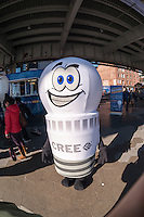 "LED mascot ""Bulbie"" greets visitors at the Great American Bulb Swap, sponsored by bulb manufacturer CREE, at the South Street Seaport in New York on Saturday, November 15, 2014. Visitors brought in a lightbulb of any type and exchanged it for an energy-saving, long-life, LED bulb made by CREE. The company expects to give out 15,000 LED bulbs during tis tour. (© Richard B. Levine)"