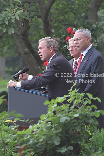 United States President George W. Bush delivers remarks in the Rose Garden of the White House in Washington, D.C. following his Executive Order regarding United States financial sanctions against terrorist networks, Monday, September 24, 2001 as U.S. Secretary of State Colin Powell, right, and U.S. Secretary of the Treasury Paul O'Neill, center, listen at his side..Mandatory Credit: Tina Hager - White House via CNP.