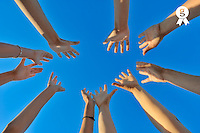Group of hands raised on blue sky, low angle view (Licence this image exclusively with Getty: http://www.gettyimages.com/detail/103544605 )
