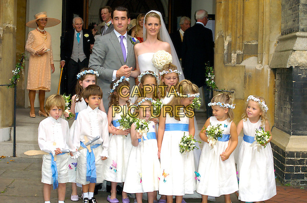 LOUIS BUCKWORTH & CHLOE DELEVIGNE.At their wedding, St. Paul's Church, Knightsbridge,.London, England, September 7th 2007..half length marriage bride groom whire bridal strapless gown dress viel flowers bouquet grey suit purple tie bridesmaids.CAP/CAN.©Can Nguyen/Capital Pictures