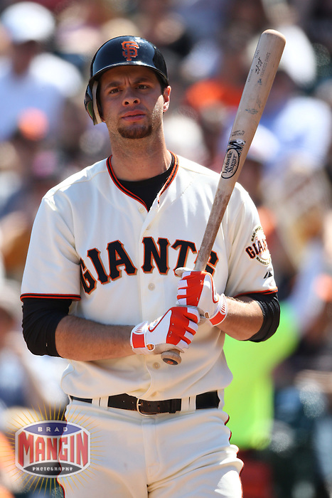 SAN FRANCISCO, CA - AUGUST 12:  Brandon Belt #9 of the San Francisco Giants bats against the Colorado Rockies during the game at AT&T Park on Sunday, August 12, 2012 in San Francisco, California. Photo by Brad Mangin