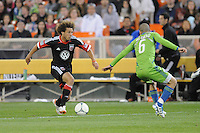 D.C. United midfielder Nick DeLeon (18) goes against Seattle Sounders midfielder Osvaldo Alonso (6) D.C. United tied the Seattle Sounders, 0-0 at RFK Stadium, Saturday April 7, 2012.