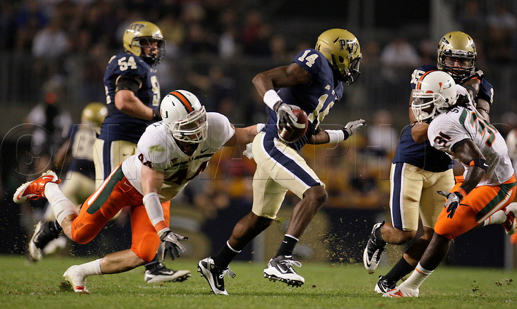 Miami Hurricanes linebacker Colin McCarthy (44) and  linebacker Sean Spence (31) chase Pittsburgh Panthers wide receiver Greg Cross (14) for an 18 yard loss in the second quarter during The University of Miami  vs The University of Pittsburgh Panthers at Heinz Field in Pittsburgh, PA, on Thursday, September 23, 2010.