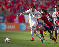 Spain forward Alvaro Negredo (22) and USA defender   Eric Lichaj (14) battle for loose ball. In a friendly match, Spain defeated USA, 4-0, at Gillette Stadium on June 4, 2011.