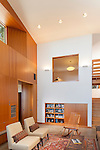 A wood wall with built-ins in the living room of a contemporary island home. This image is available through an alternate architectural stock image agency, Collinstock located here: http://www.collinstock.com