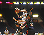 "Ole Miss' Kayla Melson (20) shoots as Arizona's Soana Lucet (53) at the C.M. ""Tad"" Smith Coliseum in Oxford, Miss. on Thursday, November 18, 2010. Arizona won 72-70."