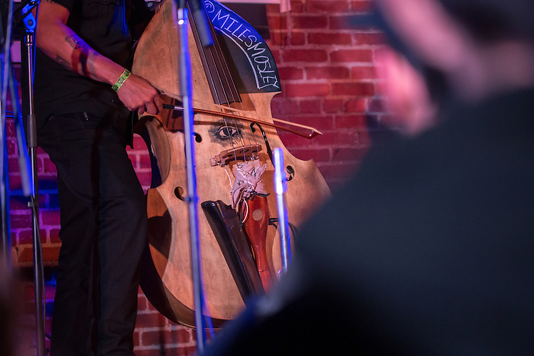 "Durham, North Carolina - Friday May 6, 2016 - Bassist Miles Mobley plays ""Abraham"" during the performance by Kamasi Washington during the Art of Cool Festival Friday night at The Armory in Durham."
